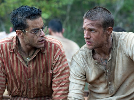 "Rami Malek, left, and Charlie Hunnam star in ""Papillon."" The movie opens Friday at R/C Hanover Movies."