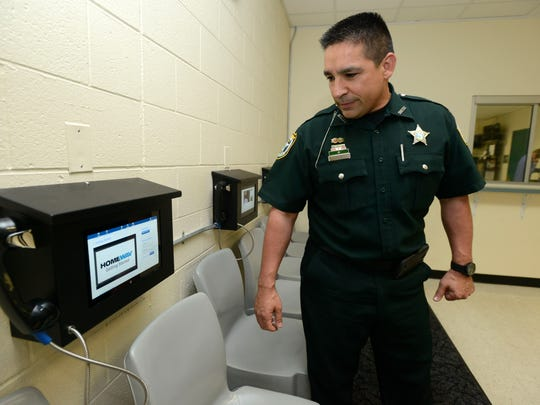 Deputy Rich Aloy, Santa Rosa County Sheriff's Office spokesman, shows one of three video visitation kiosks for visitors to the Santa Rosa County Jail. Inmates with have access to 20 kiosks within the jail to communicate with family through a monitored internet connection. In-person visitation will be discontinued after the kiosks go live on April 27.