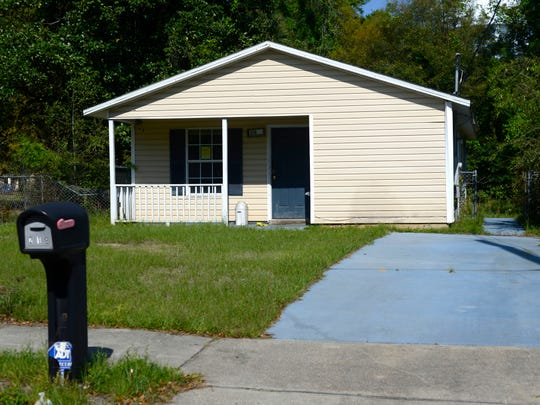 """Cash problems have prompted Pensacola Habitat for Humanity to sell 20 foreclosed houses and vacant lots, like this one located at 218 North Devilliers Street, in a """"bundle"""" to a for-profit buyer."""