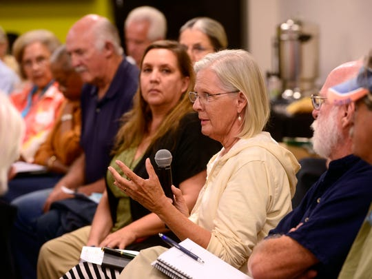 Concerned citizens gather at the Pensacola News Journal for a forum on the five year anniversary of the Deepwater Horizon oil spill.