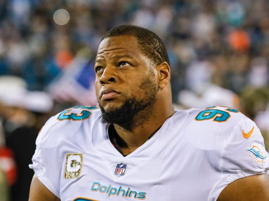 "File-This Nov. 13, 2017, file photo shows Miami Dolphins' Ndamukong Suh (93) on the sidelines before an NFL football game against the Carolina Panthers in Charlotte, N.C.  Suh won't become a New York Jet. Acting owner Christopher Johnson said Sunday the team has rescinded its offer to the free agent defensive tackle. Johnson was vague on reasons for the move, admitting though that it ""didn't seem to be in keeping with our long-term plan."" (AP Photo/Bob Leverone, File)"