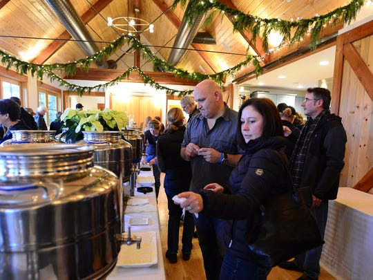 Carrie and Ed Ariniello of Sherwood faste olive oils during the Olio Nuovo Festival at the Oregon Olive Mill at Red Ridge Farms in Dayton on Sunday, Nov. 23, 2014.