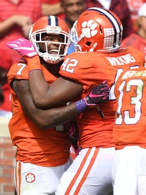 Clemson wide receiver Mike Williams (7) celebrates with defensive lineman Christian Wilkins (42) after catching a TD against North Carolina State during the 2nd quarter on Saturday, October 15, 2016 at Clemson's Memorial Stadium.