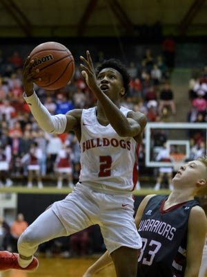 Bosse's Mekhi Lairy (2) drives to the net during the IHSAA Class 3A semi state match up against the Danville Warriors at the Hatchet House in Washington, Ind., Saturday, March 17, 2018.