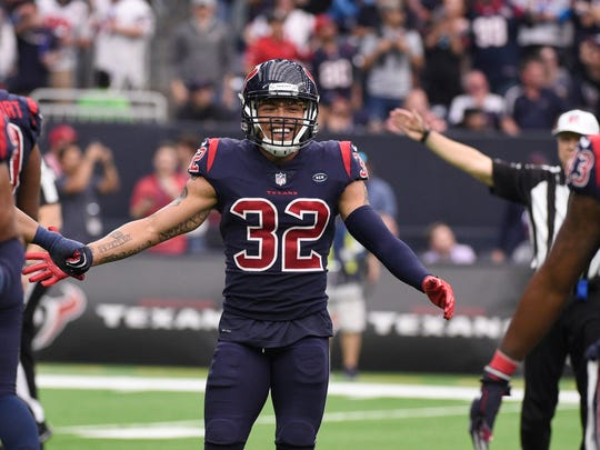 Houston Texans free safety Tyrann Mathieu (32) celebrates with teammates after the Texans recovered a Cleveland Browns fumble during the second half of an NFL football game, Sunday, Dec. 2, 2018, in Houston. (AP Photo/Eric Christian Smith)