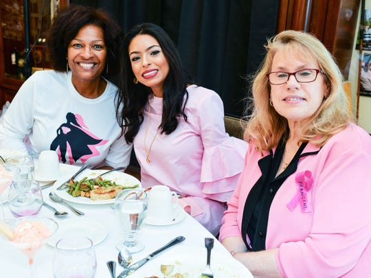 Denise Zollicoffer, left, Zineb Torres and Lee McCaskill celebrate the Super Heroes of Breast Cancer at the Friends in Pink annual luncheon on Oct.7.