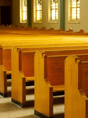 Rows of pews in church.