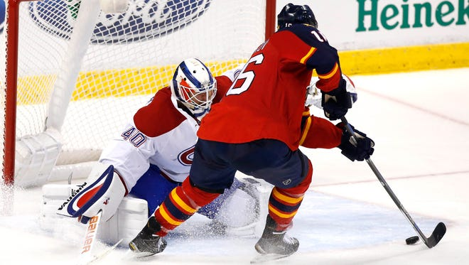 Florida Panthers center Aleksander Barkov (16) scores a goal past Montreal Canadiens goalie Ben Scrivens (40) in the third period at BB&T Center.
