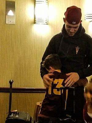 Jacob, who was caught crying on TV, hugs ASU senior guard Kodi Justice after Wednesday's loss.