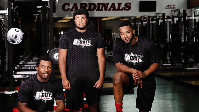 Louisville football players James Burgess, left, GG Robinson, center, Keith Kelsey and Trey Smith, not pictured, all have father's that played in the NFL and inspire them to excel in the sport.