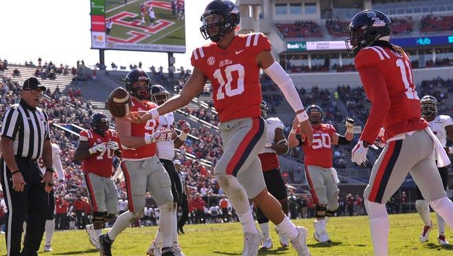 Ole Miss Rebels quarterback Jordan Ta'amu (10) scores a touchdown against the Louisiana-Lafayette Ragin Cajuns during the first half at Vaught-Hemingway Stadium. Mandatory Credit: Justin Ford-USA TODAY Sports