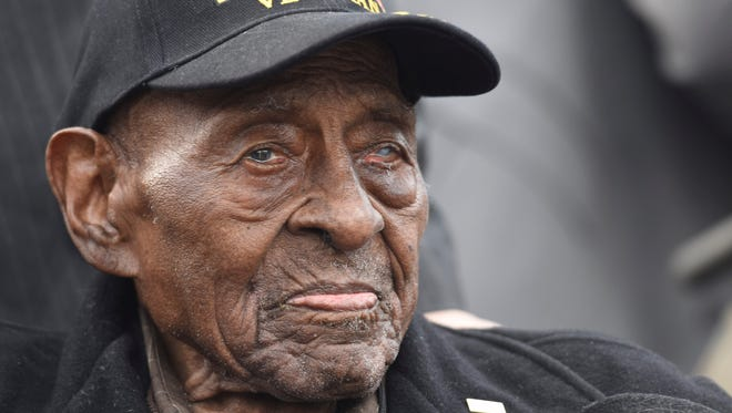 Frank Levingston, 110, a Pearl Harbor survivor joins other veterans at the World War II memorial  in Washington D.C. to observe Pearl Harbor Remembrance Day. Levingston is believed to be the oldest living WWII veteran.
