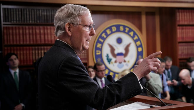 Senate Majority Leader Mitch McConnell talks to reporters on Capitol Hill on April 7, 2017.