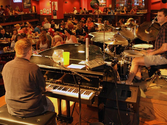 At dueling-piano bar The Shout House,Thursday's special is $5 bombers, and you can get half-off bottles and buckets for groups of four or more on Fridays.
