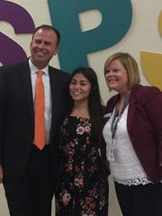 Superintendent John Jungmann takes a photo with Sophya Batista, who takes classes online, and Nichole Lemmon, director of blended learning for Springfield Public Schools.