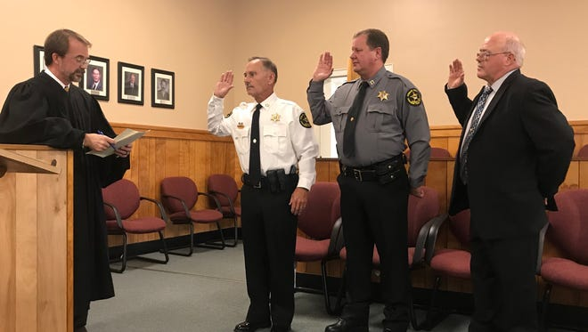 General Sessions Judge Andy Brigham, left, administers the oath of office to,from left, Sheriff Frankie Gray, Chief Deputy Dale Ward, and Jail Administrator Kenny Anderson.