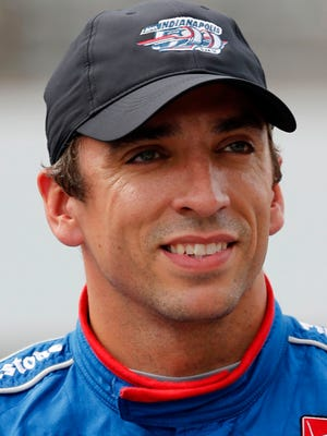 File-This file photo of May 16, 2015, shows Justin Wilson, of England, posing for a photo after he qualified for the Indianapolis 500 auto race at Indianapolis Motor Speedway in Indianapolis. Wilson has died from a head injury suffered when a piece of debris struck him at Pocono Raceway. He was 37. IndyCar made the announcement on Monday, Aug. 24, 2015, at Indianapolis Motor Speedway. (AP Photo/Dave Parker, File)