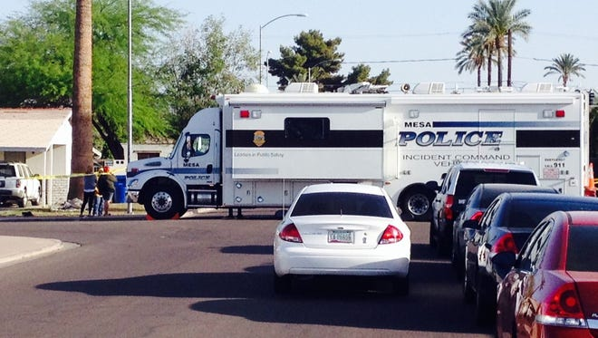Mesa police on the scene where a man's was found dead in the street.