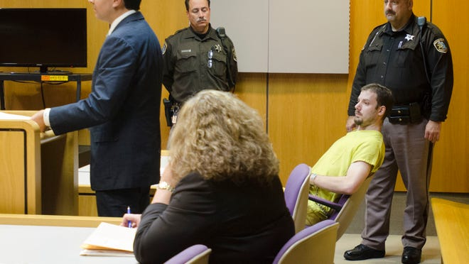 Dressed in yellow, James Donald VanCallis listens while his defense lawyer, Dean Ankouny, asks to withdraw as VanCallis' legal counsel on Thursday in Macomb County Circuit Judge Denis LeDuc's courtroom. VanCallis is charged with first-degree murder, felony murder and assault with intent to commit sexual penetration in the death of 14-year-old April Millsap.