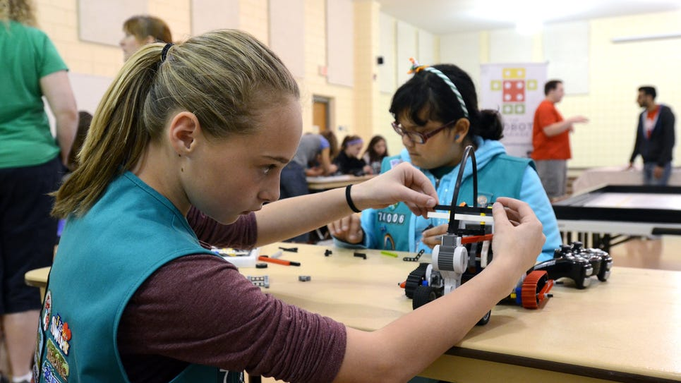 Ryann Makowski, 10, works on her robot with Lexi Martinez,