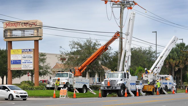 Electric crews with Pike and FPL replace poles and power lines on Merritt Island after Hurricane Matthew in October, 2016.