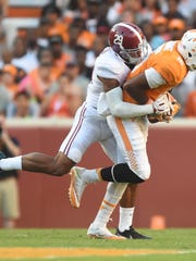 Alabama defensive back Minkah Fitzpatrick (29) stops Tennessee wide receiver Jauan Jennings (15) during the second half at Neyland Stadium on Saturday, Oct. 15, 2016.