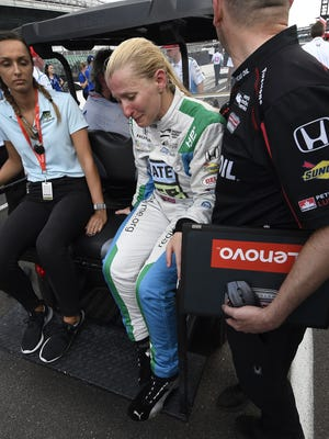 An emotional Dale Coyne Racing IndyCar driver Pippa Mann (63) after failing to make the field of 33 cars on qualification day for the Indianapolis 500 at the Indianapolis Motor Speedway on Saturday, May 19, 2018.