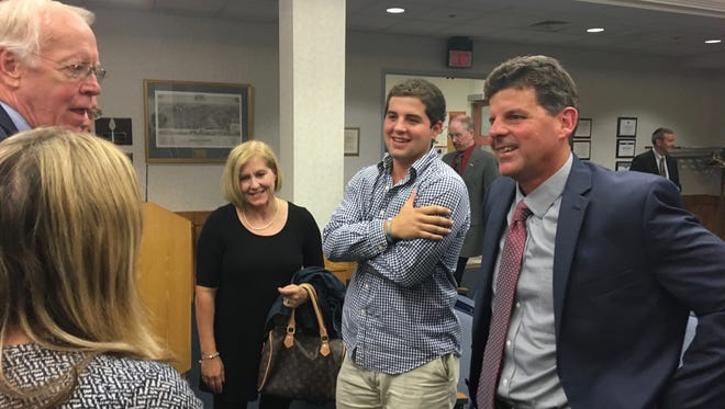 Garett Smith (right), of Newport News, talks with members of the Staunton School Board, alongside his wife, Wendy, and son, Andrew, after being named as the next superintendent at a called meeting on Tuesday, May 23, 2017.