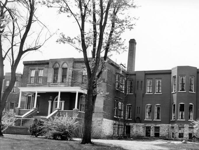 The Muskingum County home undergoing repairs in 1963.