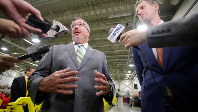 Rep. John Nygren (R-Marinette), left, co-chairman of the Joint Finance Committee talks with the media with Rep. Dale Kooyenga (R-Brookfield) before a public hearing on the state budget last month at State Fair Park in West Allis.