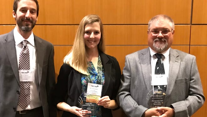 Members of the Staunton Parks and Recreation Department with two awards for the Gypsy Hill Drive-In for Children event and the Montgomery Hall pool renovation. They were honored at the 63rd Annual Conference of the Virginia Recreation and Park Society.