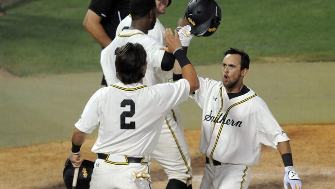 Southern Miss' Jake Sandlin celebrates with teammates after hitting a home run against Marshall in the Conference USA Baseball Tournament at Pete Taylor Park on Thursday.