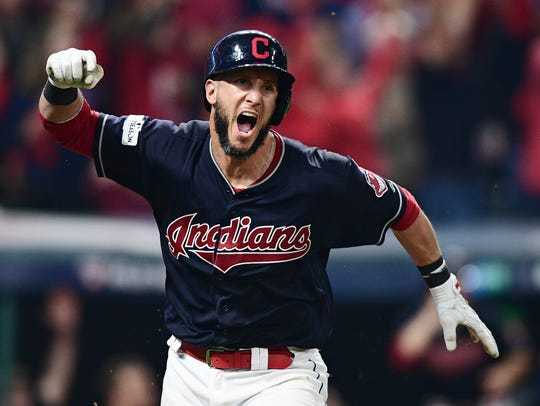Cleveland Indians' Yan Gomes celebrates after hitting