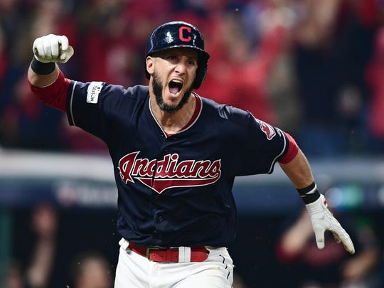 Cleveland Indians' Yan Gomes celebrates after hitting a game-winning single off New York Yankees relief pitcher Dellin Betances in the 13th inning of Game 2 of a baseball American League Division Series, Friday, Oct. 6, 2017, in Cleveland. Austin Jackson scored on the play. The Indians won 9-8.