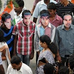Members of the Karnataka State Youth Congress, seen wearing masks of the four convicted rapists, stand amid a crowd ahead of a demonstration following the sentencing in New Delhi of four men convicted of rape and murder, in Bangalore last Friday. An Indian judge on September 13 sentenced to death four men convicted of the fatal gang rape of a student on a New Delhi bus, fulfilling the dying wish of the 23-year-old victim.