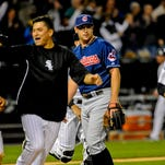 Cleveland Indians relief pitcher Bryan Shaw looks on as Chicago White Sox players rush Moises Sierra after he drove in the winning run with a single in the ninth inning of Wednesday's game in Chicago.