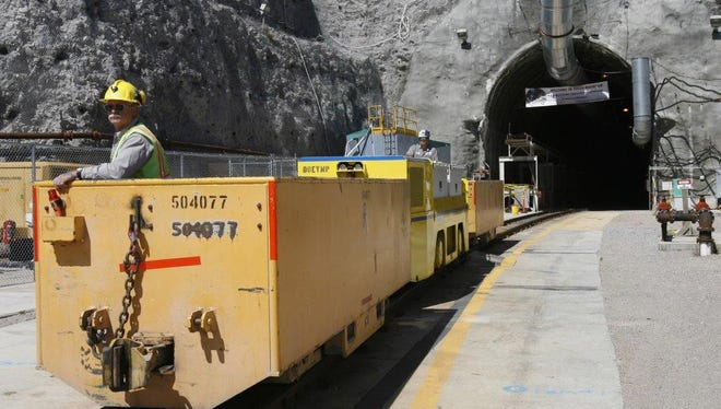Pete Vavricka conducts an underground train from the entrance of Yucca Mountain in Nevada in this April 2006 photo.