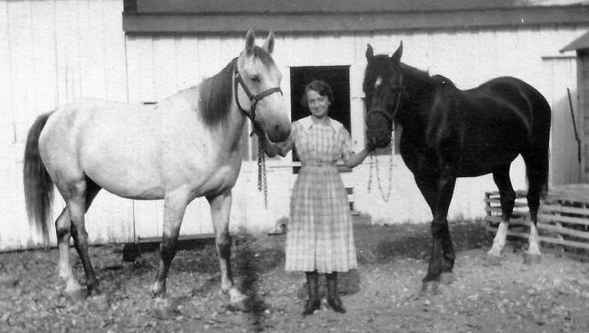 This early 20 th -century photograph taken in southern Augusta County shows a farm woman, probably Beulah Arehart Runkle, with an unknown farm horse on the left and her horse, Roy, on the right.