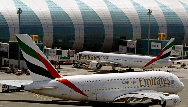 Emirates passenger planes at Dubai airport in United Arab Emirates.