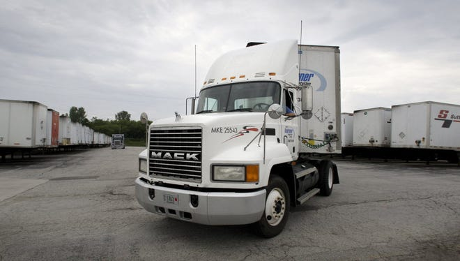 A Roadrunner Transportation Systems truck pulls out of the company yard in Cudahy.