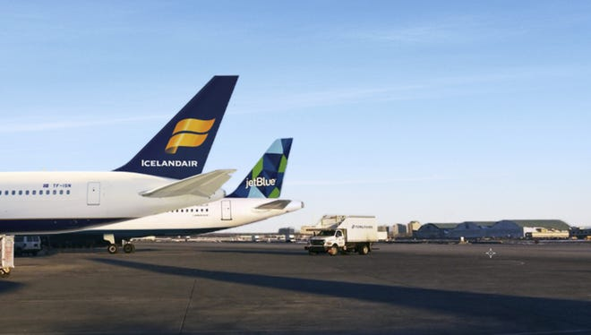 This image provided by Icelandair shows the tails of planes for Icelandair (front) and JetBlue.