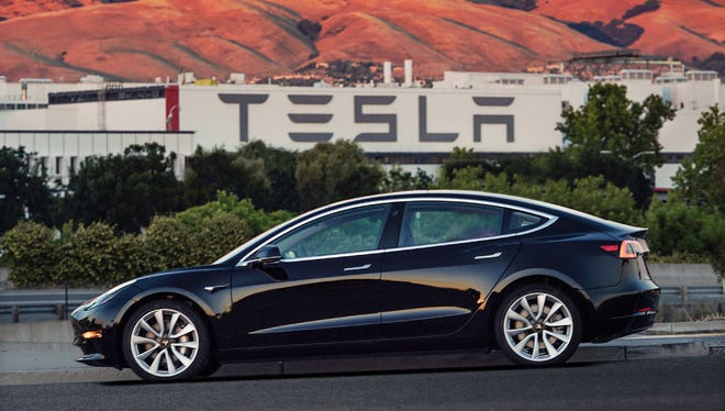 Wisconsin law dictates that vehicle manufacturers cannot directly own dealerships. Two bills would let electric vehicle companies, such as Tesla, do so.