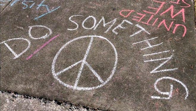 Sidewalk messages written by Plant High School seniors, Tampa, Fla., Feb. 16, 2018.