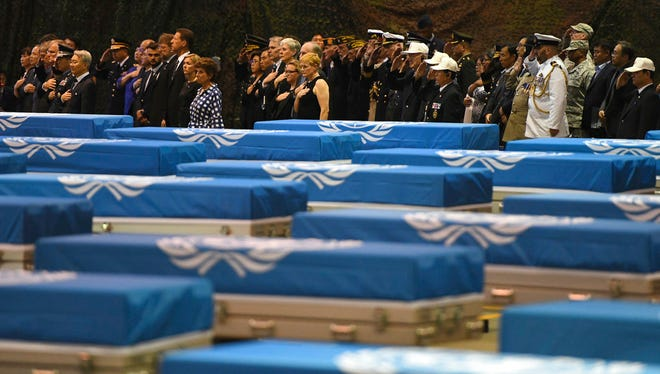 Attendees salute during a repatriation ceremony for the remains of U.S. soldiers who were killed in the Korean War and collected in North Korea, at the Osan Air Base in Pyeongtaek, South Korea, Wednesday, Aug. 1, 2018. North Korea handed over 55 boxes of the remains last week as part of agreements reached during a historic June summit between its leader Kim Jong Un and U.S. President Donald Trump.