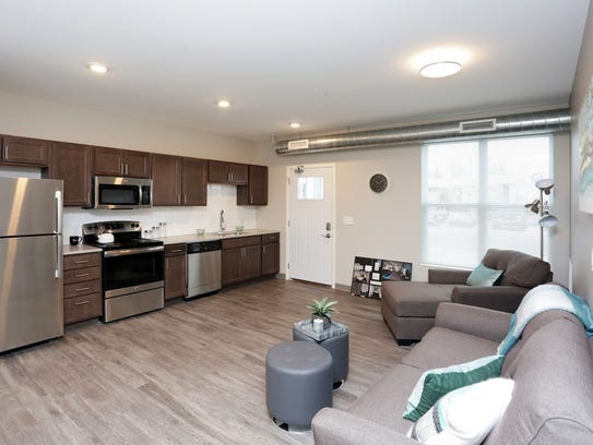 A living room and kitchen in Forest Avenue Village,