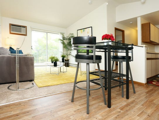 A kitchen and living room in the Somerset Apartments,