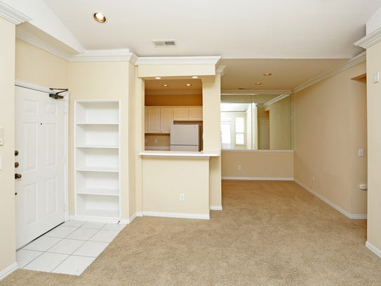 A living room in the SaddleBrook Apartments, 8301 Colby