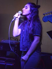 Gianna Minichiello, 15, puts heart and vocal pipes into a song. She sang for an enthusiastic group of family and friends at Weekend Willie's.