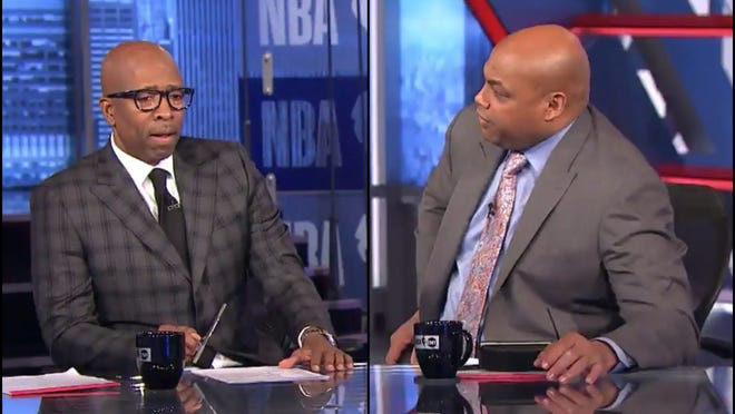 TNT analyst Charles Barkley (right) chats with Kenny Smith on set. Barkley is a big believer in the Milwaukee Bucks after Game 4.