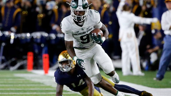 FILE - In this Sept. 17, 2016, file photo, Michigan State wide receiver Donnie Corley (9) heads down field during the first half of an NCAA college football game against Notre Dame, in South Bend, Ind. Freshman Donnie Corley is emerging as a bright spot in a bad season at Michigan State. (AP Photo/Charles Rex Arbogast, File)